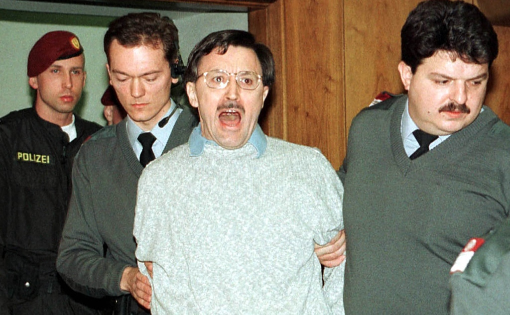 LETTER BOMBS: Former engineer Franz Fuchs was charged with letter bomb attacks likened to those of the U.S. Unabomber. Here shouting while two officers escort him in the court room in Graz, Austria on Tuesday February 2, 1999. PHOTO: Helge O. Sommer/AP