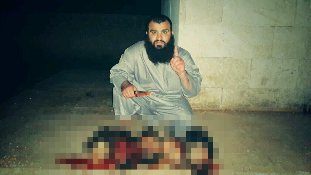A picture allegedly showing Khalid K with five decapitated heads. The picture was originally shared on Twitter, and has been pixelated by HSI.