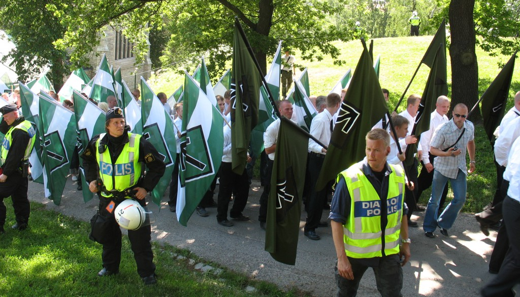 Members of the neo-Nazi organization Swedish Resistance Movement (Svenska motståndsrörelsen) demonstrating on the Swedish National Day of 2007. Photo: Peter Isotalo. Released to the public domain.